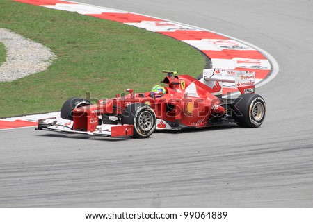 SEPANG, MALAYSIA - MARCH 23: Brazilian Felipe Massa of Ferrari in action during Friday practice at Petronas Formula 1 Grand Prix on March 23, 2012 in Sepang, Malaysia - stock photo