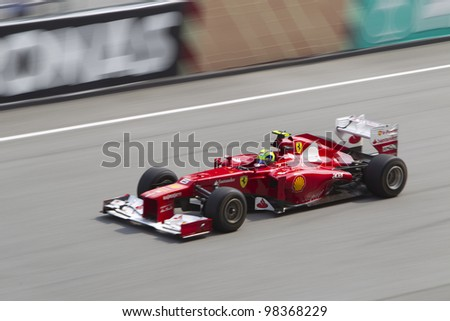 SEPANG, MALAYSIA - MARCH 23: Brazilian Felipe Massa of Team Scuderia Ferrari down the main straight during Friday practice at Petronas Formula 1 Grand Prix March 23, 2012 in Sepang, Malaysia - stock photo