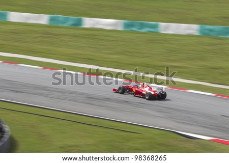 SEPANG, MALAYSIA - MARCH 23: Brazilian Felipe Massa of Team Scuderia Ferrari exits turn 9 during Friday practice at Petronas Formula 1 Grand Prix March 23, 2012 in Sepang, Malaysia