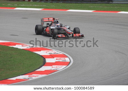 SEPANG, MALAYSIA - MARCH 23: British Jenson Button of McLaren-Mercedes in action during Friday practice at Petronas Formula 1 Grand Prix on March 23, 2012 in Sepang, Malaysia - stock photo