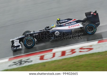 SEPANG, MALAYSIA-MARCH 25: Bruno Senna of Williams F1 Team action on wet track during race day of F1 Petronas Malaysian Grand Prix at Sepang F1 circuit on March 25, 2012 in Sepang, Malaysia - stock photo