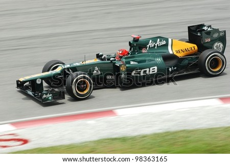 SEPANG, MALAYSIA - MARCH 24 : Caterham-Renault Team driver Heikki Kovalainen in action during Petronas F1 Malaysian Grand Prix third practice session at Sepang Circuit on March 24, 2012 in Sepang - stock photo