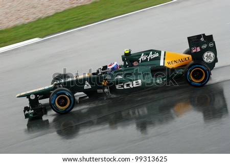 SEPANG, MALAYSIA-MARCH 25 : Caterham-Renault Team driver Vitaly Petrov on wet track during race day of F1 Petronas Malaysian Grand Prix at Sepang F1 circuit on March 25, 2012 in Sepang, Malaysia - stock photo