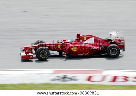 SEPANG, MALAYSIA - MARCH 23: Fernando Alonso (team Ferrari) at first practice on Formula 1 GP, March 23 2012, Sepang, Malaysia - stock photo