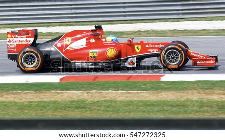 SEPANG, MALAYSIA - 30 March 2014: Ferrari Team driver, Fernando Alonso, in action during Petronas Malaysian Grand Prix practice session at Sepang F1 circuit.