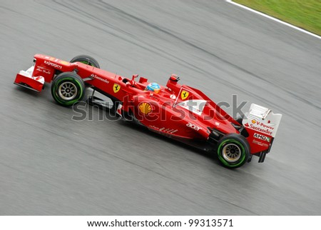 SEPANG, MALAYSIA - MARCH 25 : Ferrari Team driver Fernando Alonso of Spain in action during race day of F1 Petronas Malaysian Grand Prix at Sepang F1 circuit on March 25, 2012 in Sepang, Malaysia - stock photo