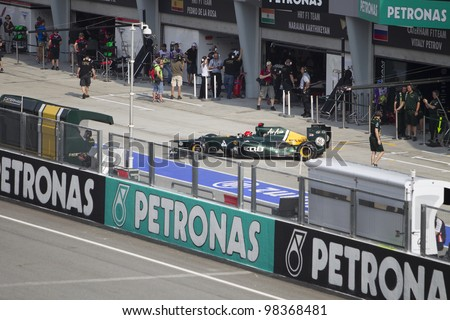 SEPANG, MALAYSIA - MARCH 23: Finnish Heikki Kovalainen of Team Caterham exits the pit during Friday practice at Petronas Formula 1 Grand Prix March 23, 2012 in Sepang, Malaysia - stock photo