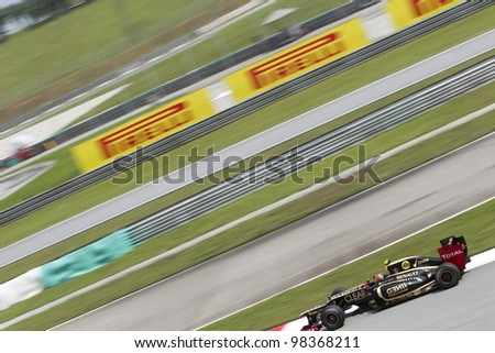 SEPANG, MALAYSIA - MARCH 23: French Romain Grosjean of Team Lotus exits turn 15 during Friday practice at Petronas Formula 1 Grand Prix March 23, 2012 in Sepang, Malaysia - stock photo