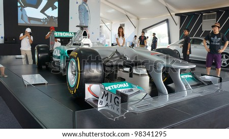 SEPANG, MALAYSIA-MARCH 23 : Front view of Petronas Mercedes GP F1 car on display during the Malaysian F1 Grand Prix on March 23, 2012 in Sepang International Circuit in Sepang, Malaysia. - stock photo