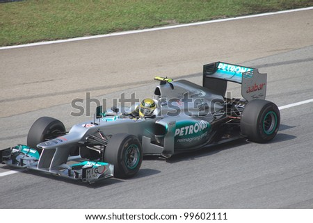 SEPANG, MALAYSIA - MARCH 23: German Nico Rosberg of Mercedes in action during Friday practice at Petronas Formula 1 Grand Prix on March 23, 2012 in Sepang, Malaysia - stock photo