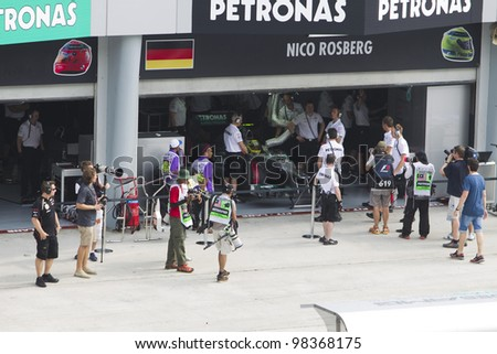 SEPANG, MALAYSIA - MARCH 23: German Nico Rosberg of Team Mercedes AMG prepares for Friday practice at Petronas Formula 1 Grand Prix March 23, 2012 in Sepang, Malaysia - stock photo