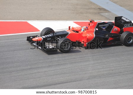 SEPANG, MALAYSIA - MARCH 23: German Timo Glock of Marussia-Cosworth in action during Friday practice at Petronas Formula 1 Grand Prix on March 23, 2012 in Sepang, Malaysia