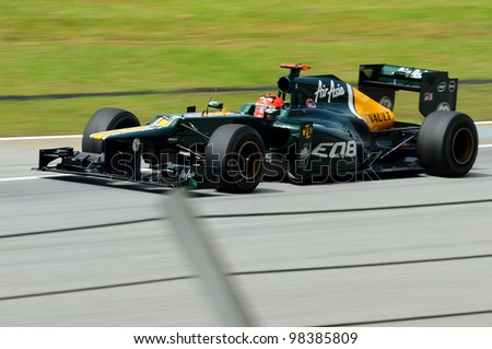 SEPANG, MALAYSIA - MARCH 23: Heikki Kovalainen of Caterham-Renault in action at PETRONAS Malaysian Grand Prix on March 23, 2012 in Sepang, Malaysia.The race will be held on Sunday March 25, 2012 - stock photo