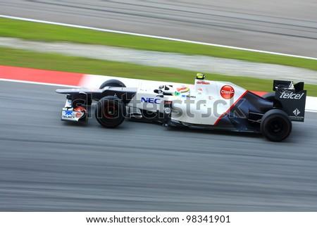 SEPANG, MALAYSIA - MARCH 23: Kamui Kobayashi of Sauber F1 team races during Formula One Teams Test Days at Sepang circuit on March 23, 2012 in Sepang, Malaysia. - stock photo