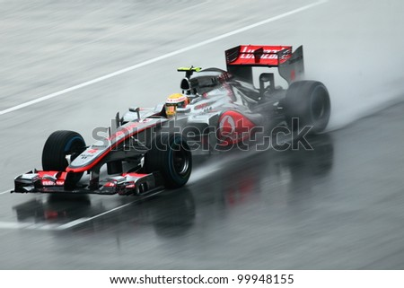 SEPANG,MALAYSIA-MARCH 25: Lewis Hamilton  of McLaren team in action in rain-hit Formula One PETRONAS Malaysian Grand Prix at Sepang F1 Circuit on March 25,2012 in Sepang, Malaysia. Alonso won the race - stock photo