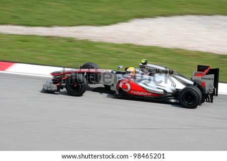SEPANG, MALAYSIA - MARCH 23: Lewis Hamilton of Vodafone McLaren Mercedes in action during Petronas Malaysian Grand Prix practice session at Sepang F1 circuit on March 23, 2012 in Sepang, Malaysia. - stock photo