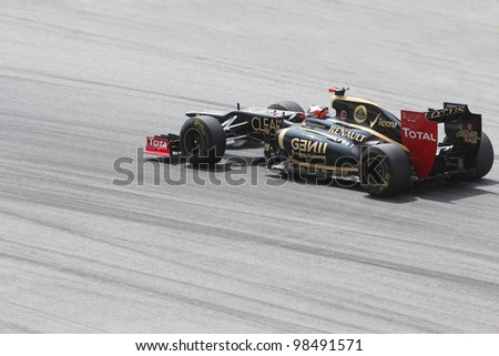 SEPANG, MALAYSIA - MARCH 24 : Lotus-Renault Team driver Kimi Raikkonen in action during Petronas F1 Malaysian Grand Prix third practice session at Sepang F1 circuit on March 24, 2012 in Sepang - stock photo