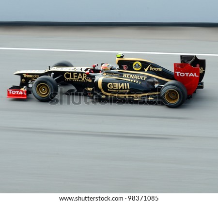 SEPANG, MALAYSIA-MARCH 23: Lotus-Renault  Team driver Romain Grosjean in action on track during Petronas Malaysian Grand Prix practice session at Sepang F1 circuit on March 23, 2012 in Sepang, Malaysia. - stock photo