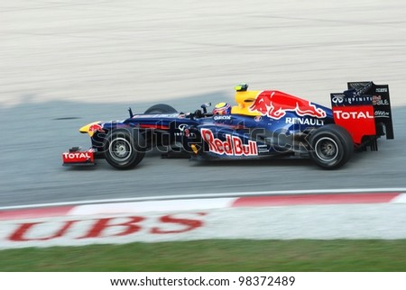 SEPANG, MALAYSIA-MARCH 24 : Mark Webber of Red Bull Racing Team in action during qualifying session on March 24, 2012 in Sepang International Circuit in Sepang, Malaysia. - stock photo