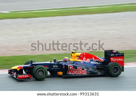 SEPANG, MALAYSIA-MARCH 25 : Mark Webber of Red Bull Racing Team in action during  race day of Petronas F1 Malaysian Grand Prix at Sepang Circuit on March 25, 2012 in Sepang, Malaysia - stock photo