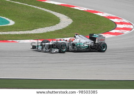 SEPANG, MALAYSIA - MARCH 23 : Mercedes driver Michael Schumacher of Germany drives during Petronas Malaysian Grand Prix  practice session at Sepang F1 circuit 23 March, 2012 in Sepang,Malaysia.