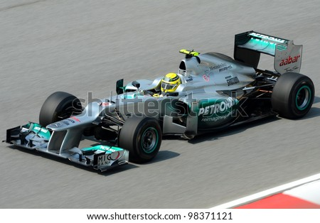 SEPANG, MALAYSIA-MARCH 23: Mercedes Team driver Nico Rosberg action on track during Petronas Malaysian Grand Prix practice session at Sepang F1 circuit on March 23, 2012 in Sepang, Malaysia. - stock photo