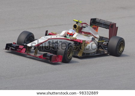 SEPANG, MALAYSIA - MARCH 23: Pedro de la Rosa of HRT F1 Team takes to the tracks on practice day of the Petronas Malaysian F1 Grand Prix on March 23, 2012 in Sepang, Malaysia.