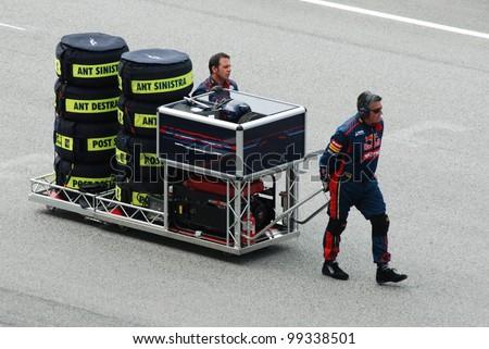 SEPANG, MALAYSIA-MARCH 25 : Pit crews move gear at Petronas F1 Malaysian Grand Prix at Sepang Circuit on March 25, 2012 in Sepang, Malaysia - stock photo