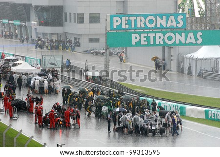 SEPANG, MALAYSIA - MARCH 25 : Race suspended on lap 9 due to torrential rain during race day of F1 Petronas Malaysian Grand Prix at Sepang F1 circuit on March 25, 2012 in Sepang, Malaysia - stock photo