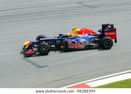 SEPANG, MALAYSIA -MARCH 23 : Red Bull Racing-Renault Team driver Mark Webber in action during Petronas Malaysian Grand Prix second practice session at Sepang F1 circuit March 23, 2012 in Sepang - stock photo