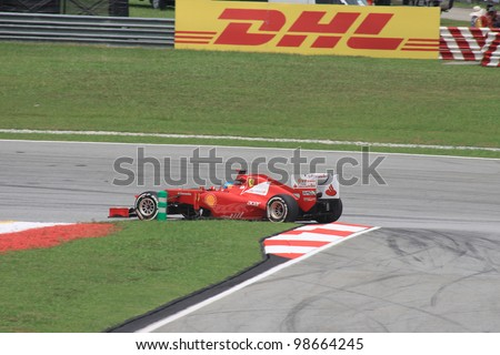 SEPANG, MALAYSIA - MARCH 23: Spanish Fernando Alonso of Ferrari in action during Friday practice at Petronas Formula 1 Grand Prix on March 23, 2012 in Sepang, Malaysia