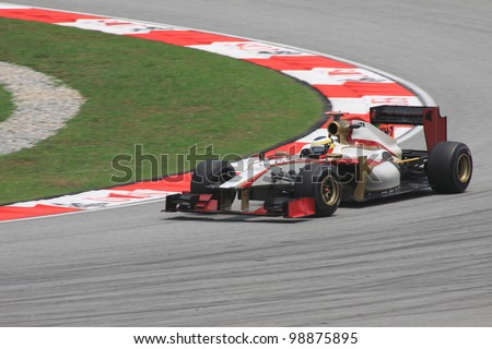 SEPANG, MALAYSIA - MARCH 23: Spanish Pedro De La Rosa of HRT-Cosworth in action during Friday practice at Petronas Formula 1 Grand Prix on March 23, 2012 in Sepang, Malaysia