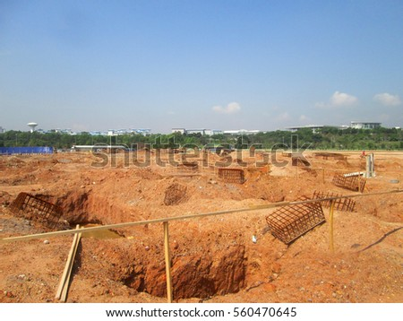 SEPANG, MALAYSIA -MAY 06, 2014: Pile cap foundation work on progress at the construction site. Construction workers excavate hole to start fabricate the pile cap capping.