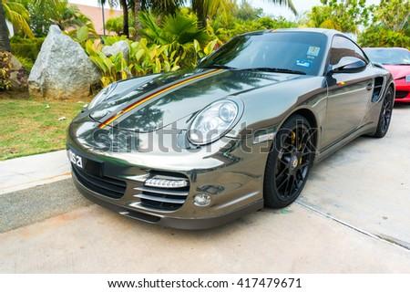 SEPANG, MALAYSIA - MAY 8, 2016: Porsche 911 Turbo S parking on the side road. Photo at AVANI Sepang Goldcoast, Bagan Lalang road. - stock photo