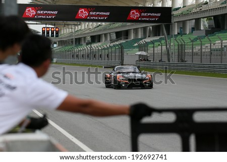SEPANG, MALAYSIA - MAY 10, 2014: The BMW car of Morris Chen and Tatsuya Tanigawa races down the straight at the free practice session of the Malaysian Super Series Round 2 in Sepang Circuit. - stock photo