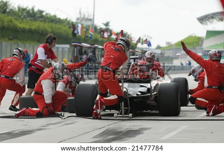 SEPANG, MALAYSIA - NOVEMBER 23 : A1 Team Indonesia changing tyres at pitstop at A1GP World Cup of Motorsport in Sepang, Malaysia November 23, 2008. - stock photo