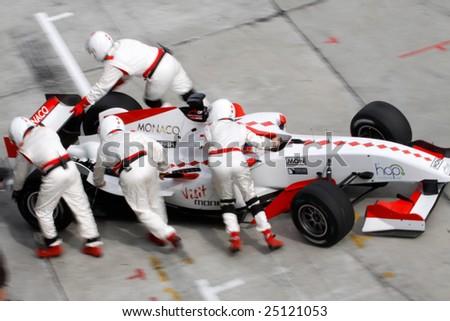 Sepang, MALAYSIA - 23 November: Team Monaco pushing cars into the pits at the World A1 GP championship races held in Malaysia. 23 November 2008 in Sepang International Circuit Malaysia. - stock photo