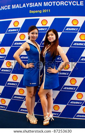 SEPANG, MALAYSIA - OCT 21: A pair of unidentified Malaysian models pose during the promotion of Shell Advance Product at the Malaysian Motorcycle Grand Prix 2011 on October 21, 2011 in Sepang, Malaysia. - stock photo
