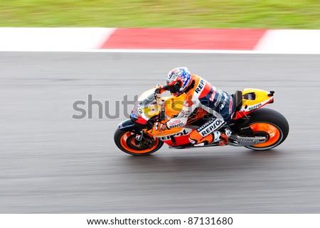 SEPANG, MALAYSIA-OCT 21: Australian Respol Honda MotoGP rider Casey Stoner during a free practice session on October 21, 2011 at Sepang, Malaysia. The Malaysian Grand Prix will take place on Oct 23. - stock photo