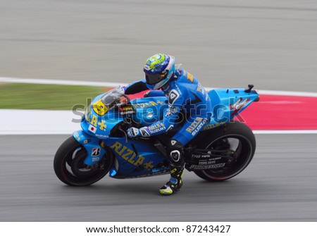 SEPANG, MALAYSIA-OCT.21:Bautista in action during practice session of Shell Advance Malaysian Moto GrandPrix on Oct. 21 2011 in Sepang, Malaysia. The MotoGP class race will be held on Oct. 23, 2011. - stock photo