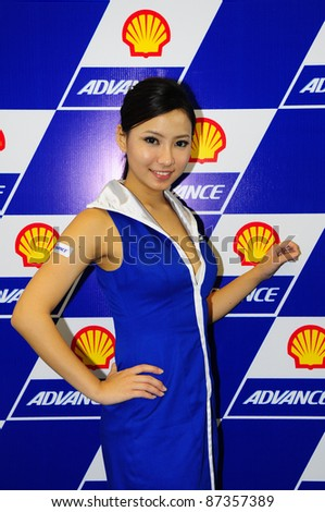 SEPANG, MALAYSIA - OCT 21:Unidentified Malaysian model pose during the promotion of Shell Advance Product at the Malaysian Motorcycle Grand Prix 2011 on October 21, 2011 in Sepang, Malaysia. - stock photo