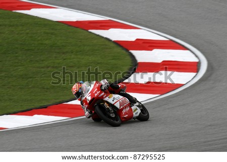 SEPANG, MALAYSIA - OCTOBER 22: 125cc rider Johann Zarco (5) competes at the qualifying session of the Shell Advance Malaysian Motorcycle Grand Prix 2011 on October 22, 2011 at Sepang, Malaysia.