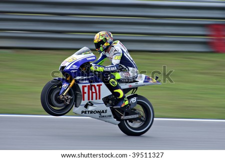 SEPANG, MALAYSIA - OCTOBER 24: Italian Valentino Rossi of Fiat Yamaha Team at the MotoGP in Shell Advance Malaysian Motorcycle Grand Prix on October 24, 2009 in Sepang, Malaysia. - stock photo