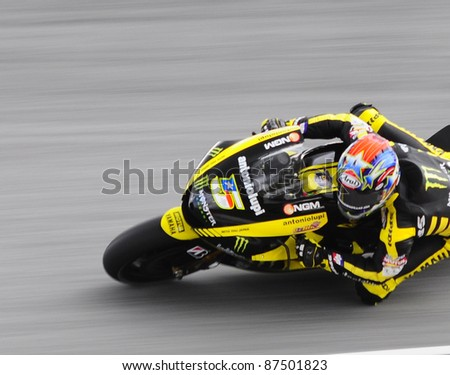 SEPANG, MALAYSIA - OCTOBER 21: MotoGP rider Colin Edwards tests his bike during the free practice session at the Shell Advance Malaysian Motorcycle GP 2011 on October 21, 2011 at Sepang, Malaysia.