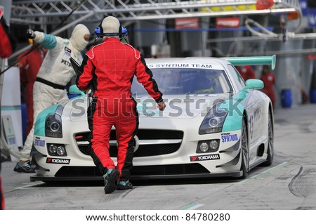 SEPANG, MALAYSIA-SEPT 16:PETRONAS Syntium Team driver in Mercedes SLS car at pitstop during GT Class qualifying session of Malaysia Merdeka Endurance Race (MMER) 2011 in Sepang, Malaysia on 16, 2011 - stock photo