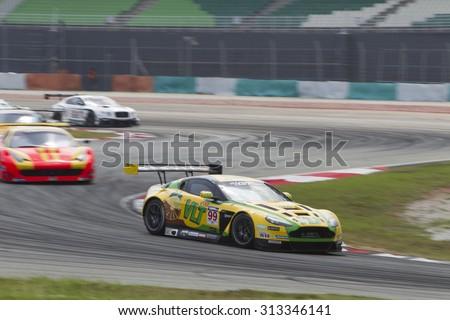 Sepang, Malaysia - September 5, 2015 : British Aston Martin car no 99 exits turn 2 at Asian Festival of Speed Race, Sepang, Malaysia  - stock photo