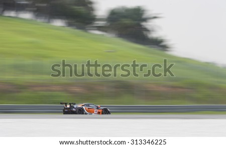 Sepang, Malaysia - September 5, 2015 : British McLaren car no 15 drives in the wet at Asian Festival of Speed Race, Sepang, Malaysia  - stock photo