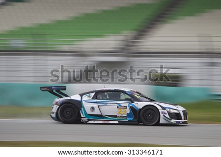 Sepang, Malaysia - September 5, 2015 : German Audi car no 23 brakes for turn 7 at Asian Festival of Speed Race, Sepang, Malaysia  - stock photo