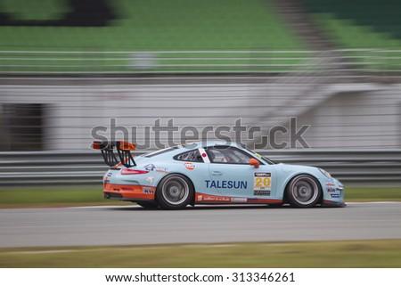 Sepang, Malaysia - September 5, 2015 : German Porsche car no 20 brakes for turn 7 at Asian Festival of Speed Race, Sepang, Malaysia  - stock photo