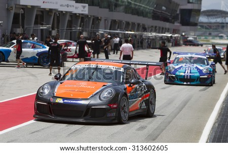 Sepang, Malaysia - September 5, 2015 : Netherlands Francis Tjia of Team Openroad Racing enters pit at Porsche Carrera Cup Asia AFOS, Sepang, Malaysia  - stock photo